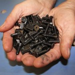 hand-full-of-tnuts-and-bolts